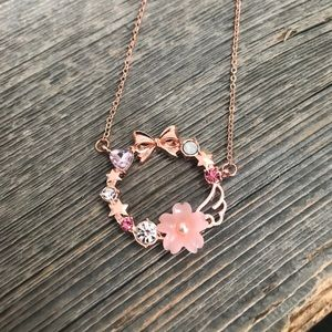 NWOT angel wing stone necklace rose gold bow